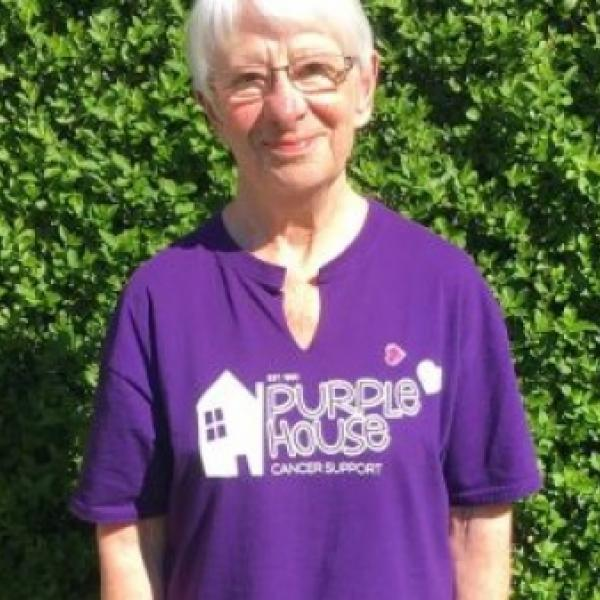A photo of Janet Smith wearing a Purple House Cancer Support tshirt