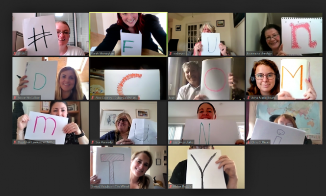 A screenshot of a Zoom call. Participants are holding up letters and together spell out #'FUNDCOMMUNITY.